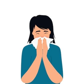 Covid-19. sintomas do coronavírus. o garoto está tossindo atrás de um guardanapo. nariz a pingar.