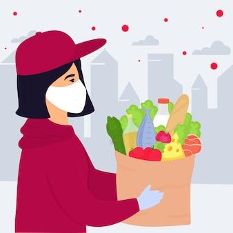 Covid19. epidemia do coronavírus. garota voluntária percorre a cidade infectada com um vírus e carrega uma parcela com comida