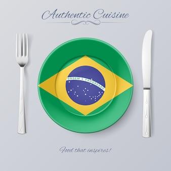 Cozinha autêntica do brasil. prato com bandeira brasileira e talheres