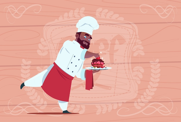 Cozinheiro americano africano, cozinheiro, segurando, sobremesa, prato, sorrindo cozinheiro americano, diretor, em, branco, restaurante, uniforme, sobre, madeira, textured, fundo
