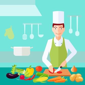 Cozinheiro chefe do processo de cozimento corta o tomate com muita vegetais na tabela