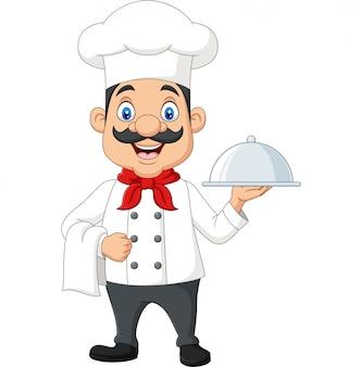 Cozinheiro chefe engraçado dos desenhos animados com um bigode segurando uma bandeja de prata