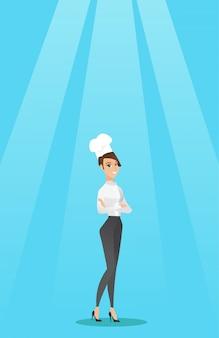 Cozinheiro chefe fêmea confiável com os braços cruzados.