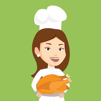 Cozinheiro chefe segurando frango assado.