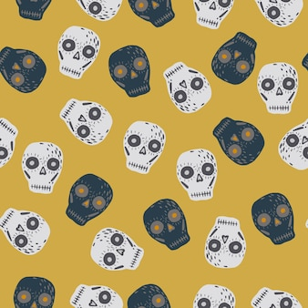 Crânios de desenhos animados ornamento padrão doodle sem emenda. formas assustadoras em cinza e azul marinho em fundo amarelo pálido