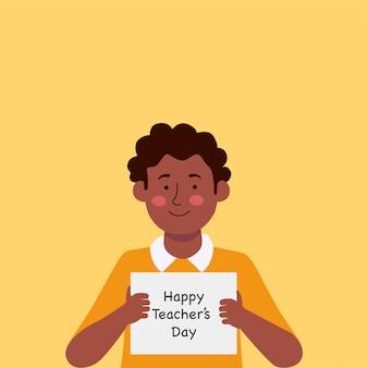 Criança com papel dizendo feliz dia do professor