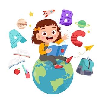 Criança feliz lê livros sobre o globo do mundo
