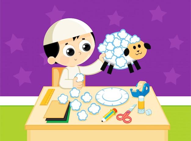 Criança muçulmana faz uma ovelha artesanal de papéis coloridos