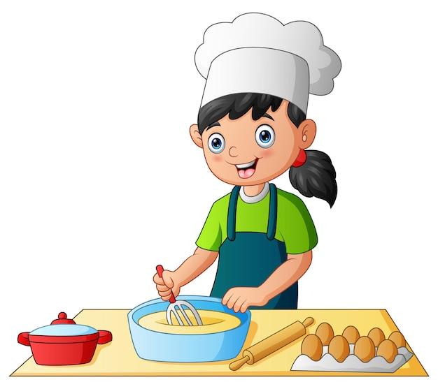 Criança na cozinha fazendo um bolo com um chapéu de chef
