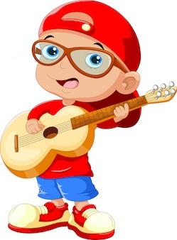 Criança pequena, vestindo um chapéu vermelho e óculos escuros tocando uma guitarra