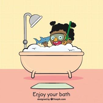 Criança que joga com um tubarão na banheira