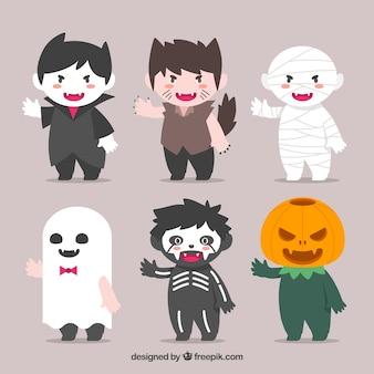 Crianças agradáveis com trajes aterrorizantes