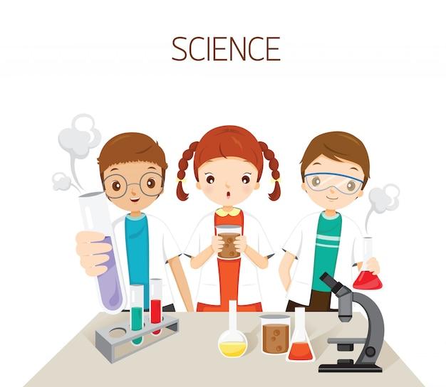 Crianças aprendendo na aula de ciências experimentando, estudante de volta à escola