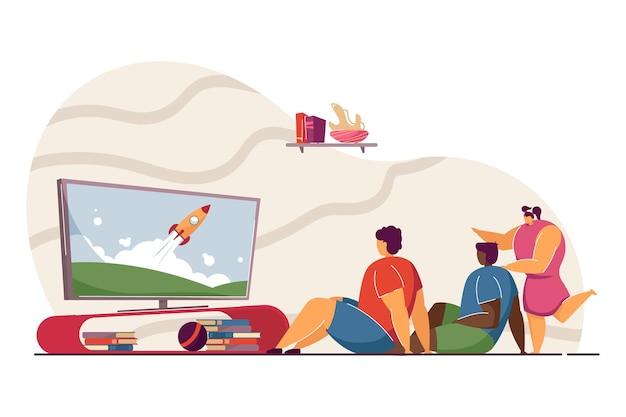 Crianças assistindo tv com foguete na tela