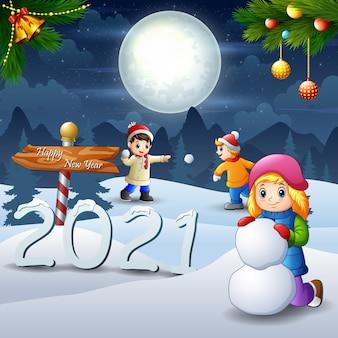 Crianças brincando de neve na véspera de natal