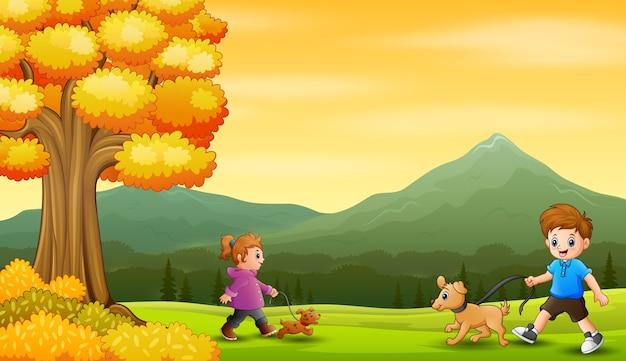Crianças caminhando com seus animais de estimação na natureza