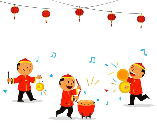 Crianças chinesas tocando música para a dança do dragão