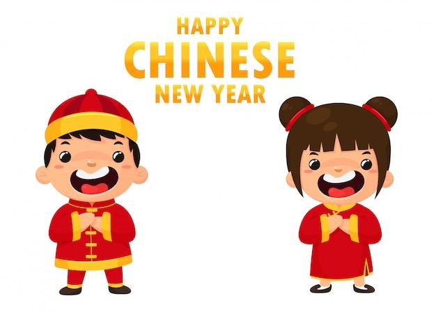 Crianças chinesas vestindo trajes nacionais saudando para o festival do ano novo chinês.