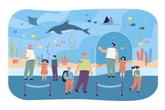 Crianças com os pais no oceanário. ilustração plana