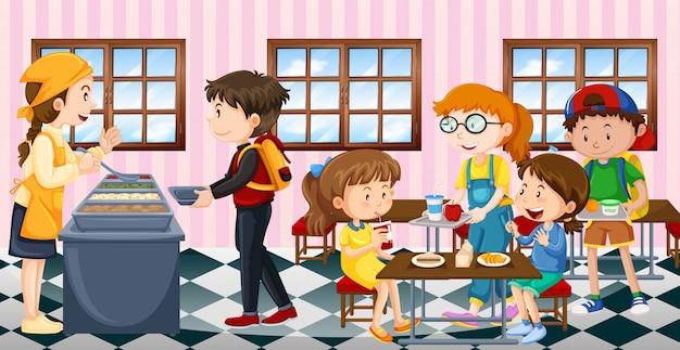 Crianças comendo almoço na cantina