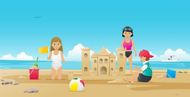 Crianças construindo castelos de areia na praia