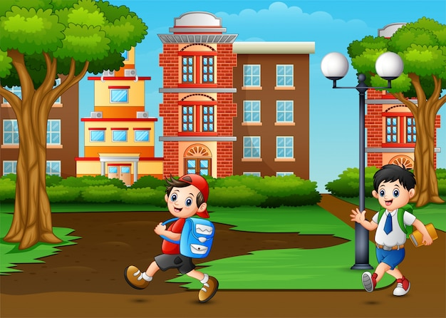 Crianças de escola felizes passam o parque da cidade