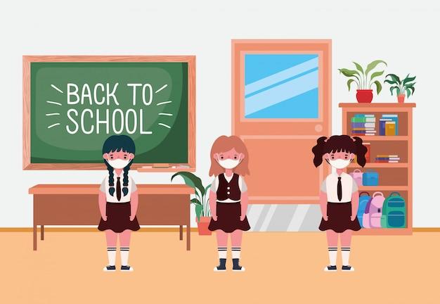 Crianças de meninas com máscaras na sala de aula