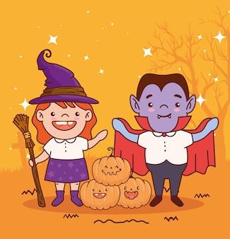 Crianças disfarçadas de bruxa e conde drácula para a feliz celebração do halloween