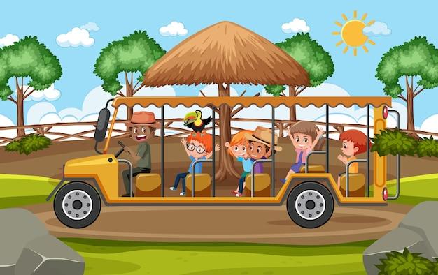 Crianças em carro de turismo exploram a cena do zoológico