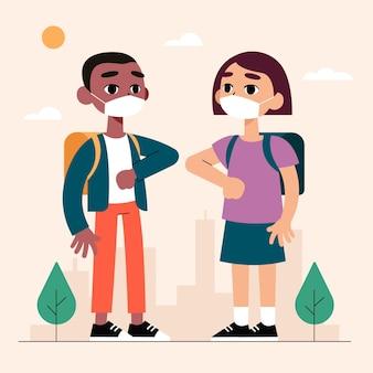 Crianças em idade escolar cumprimentando no novo normal
