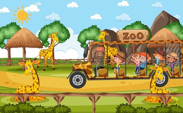 Crianças em um carro de turismo observando um grupo de girafas na cena do zoológico
