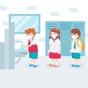 Crianças esperando na fila para lavar as mãos