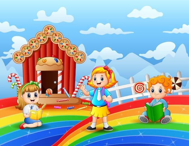 Crianças felizes aprendendo em uma terra de doces