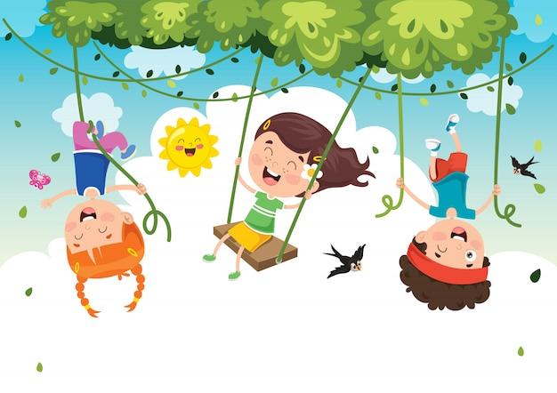 Crianças felizes, balançando com corda de raiz na selva
