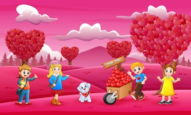 Crianças felizes comemorando um dia dos namorados no jardim-de-rosa
