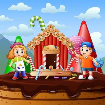 Crianças felizes pintando uma ilustração de uma casa de doces