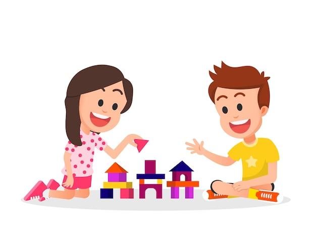 Crianças fofas brincando de blocos de construção juntos