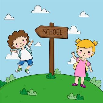 Crianças fofas e placa de direção da escola