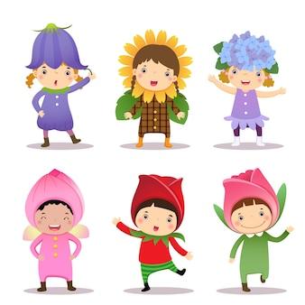 Crianças fofas vestindo fantasias de flores