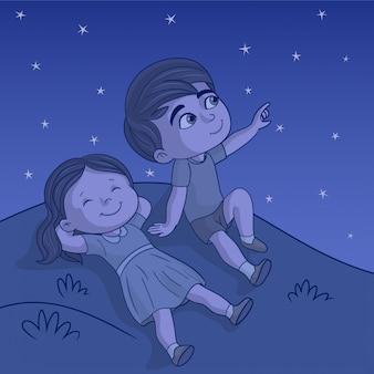 Crianças fora olhando estrelas
