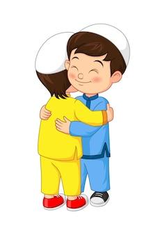 Crianças muçulmanas felizes se abraçando e comemorando o eid al fitr