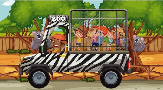 Crianças na cena safari com grupo de coala
