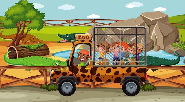 Crianças na cena safari com grupo de crocodilos