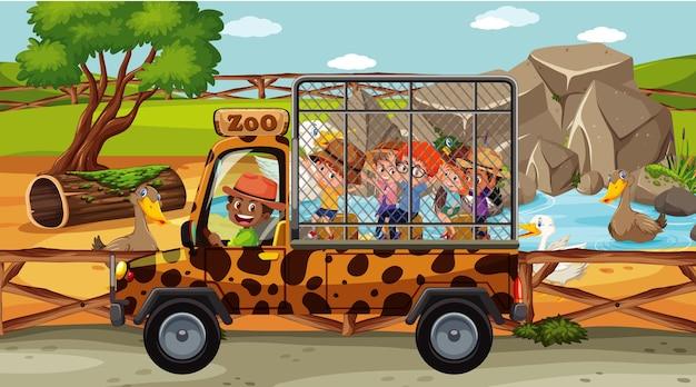 Crianças na cena safari com grupo de patos