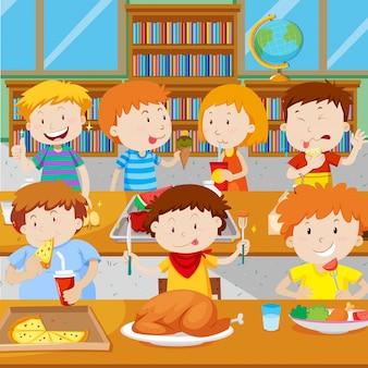 Crianças na escola que almoçam na cantina