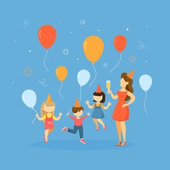 Crianças na festa de chapéu com balões.