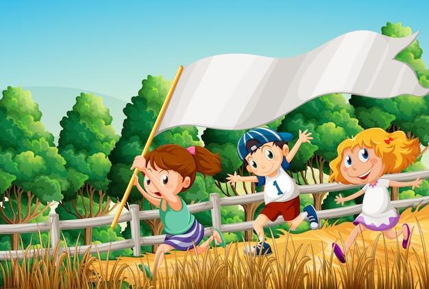 Crianças na floresta com um banner vazio