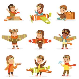 Crianças pequenas em trajes de piloto sonhando em pilotar o avião