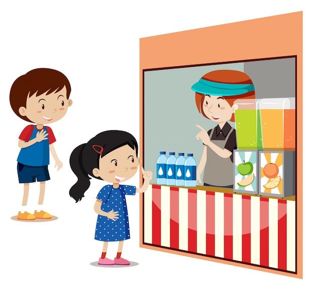 Crianças que compram bebidas na loja