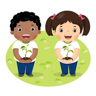 Crianças segurando uma planta jovem em um círculo de grama